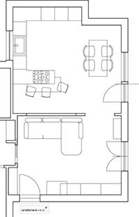 Soggiorno e cucina in un appartamento affacciato sul verde